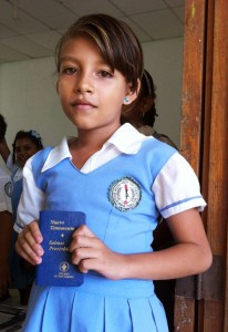 One of the students who received a Scripture from The Gideons International during the 2012 Colombia International Scripture Blitz. Gideons and Auxiliary distributed over 1.1 million Scriptures during the two-week event. © 2012 The Gideons International.