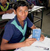 One of the young men in India who received a New Testament from Gideons during the blitz. © 2014 The Gideons International.