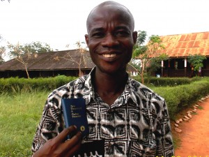 Years ago, Bright Ntow came to know Jesus through a Gideon-placed New Testament. Today, he is a teacher in Ghana, and he received his second New Testament from Gideons who distributed Scriptures to the children in his school. Photo: © 2014 The Gideons International