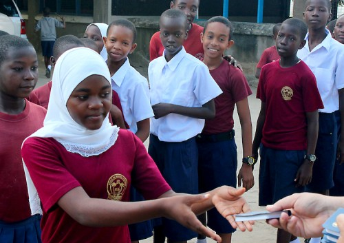 A student receives one of the 313,000+ Scriptures distributed by Gideons during the 2015 Tanzania International Scripture Blitz. © 2015 The Gideons International.