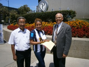 Shirley with two of the Gideons in San Jose, after she prayed to receive Christ.  © 2015 The Gideons International
