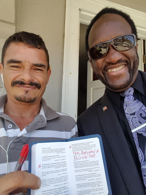 Tony (left), with Vernard, shortly after Tony signed his name in the New Testament to acknowledge he had just prayed to receive Christ. © 2015 The Gideons International