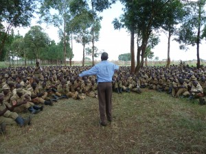 A Gideon presents the Gospel to Ugandan police cadets at a Scripture distribution.