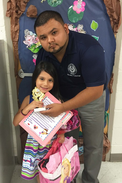 Daniel Silguero with his daughter, Danielle. Mr. Silguero found encouragement to face leukemia through his regular reading of a New Testament received from a Gideon.