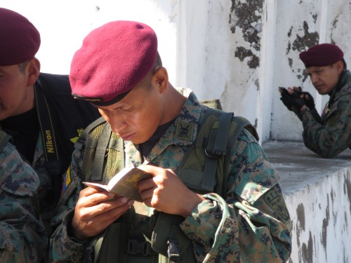 "A serviceman in a Special Forces unit in Ecuador reads his Service Testament moments after receiving it from Gideons during the 2015 Ecuador International Scripture Blitz. ""This is the greatest weapon you will own… use it, read it, and I promise you will be more effective soldiers,"" the unit's commanding officer told his troops."