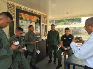 Members of the Venezuelan National Guard in Puerto la Cruz explore the Scriptures they received from Gideons during the 2016 Venezuela International Scripture Blitz.